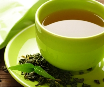 hy gHealthy green tea cup with tea leaves