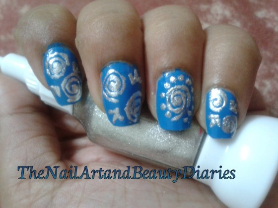 The Blue and Silver Swirls Nail Art